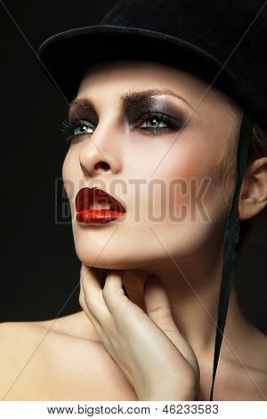 Fashion horsewoman wearing black hat