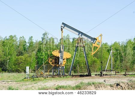 Oil Pump Works On Spring Forest Background