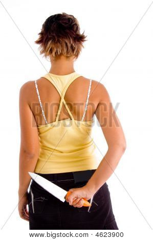 Back View Of Woman Holding Knife
