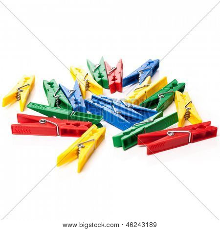 Closeup image of little colorful clothespins on a white background