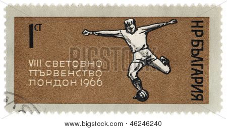 Football Player Kicks The Ball On Post Stamp