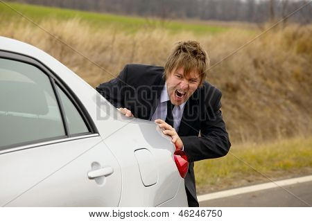 Pushing a broken down car