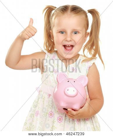 The little girl with a money box - a pig and showing ok. It is isolated on a white background