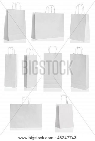 Various paper shopping bags isolated over white background