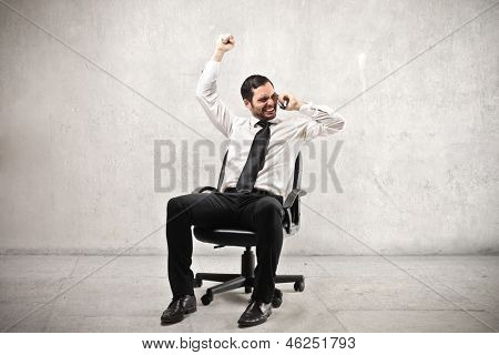 young businessman exults