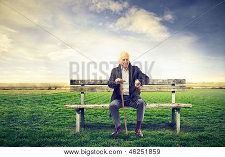 senior man sitting on a bench outdoor