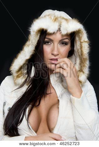 Attractive model poses with a white winter coat