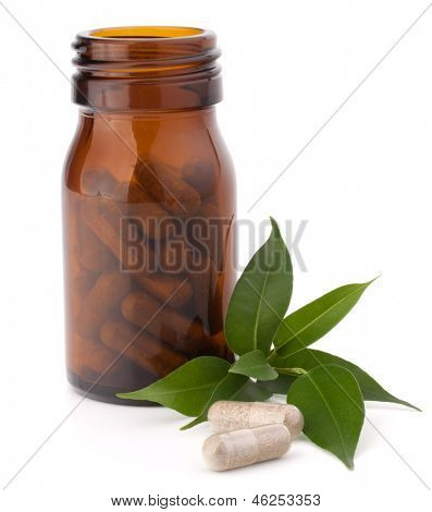 Herbal drug capsules in brown glass bottle isolated on white background cutout. Alternative medicine concept.