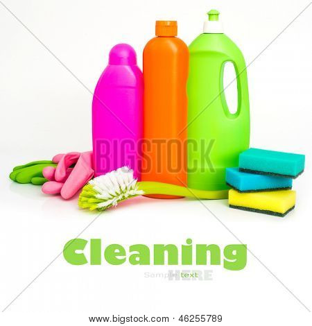 cleaning supplies and sponges  isolated over white background