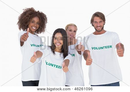 Happy group of volunteers giving thumbs up on white background