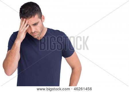 Sad man holding his forehead in white background