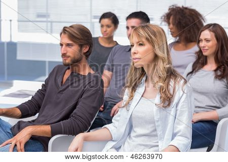 Group of patients listening at therapy and sitting in chairs