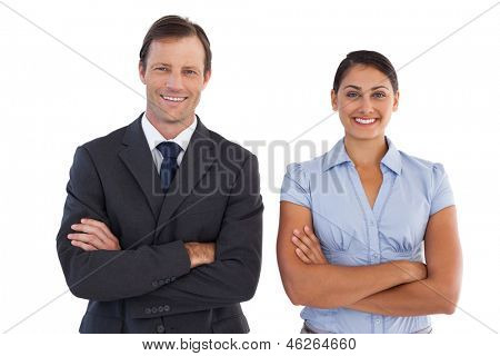 Smiling co workers standing next to each other on white background