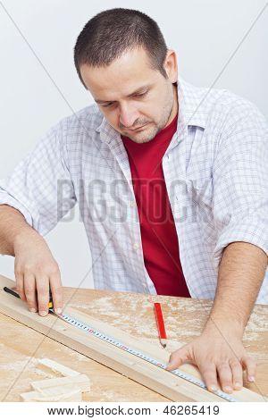 Woodwork - Man Measuring Wooden Planck