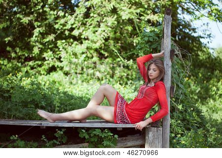 Girl In A Red Dress Lying And Resting