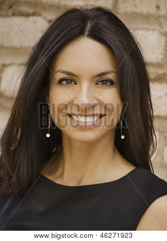 Attractive smiling business woman with long straight hair