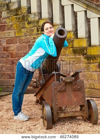 Young Woman Near An Old Cannon