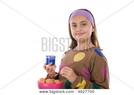 Adorable Girl Adorning Easter Eggs
