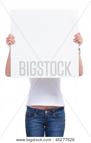 casual young woman holding an empty pannel in front of her face. isolated on white background