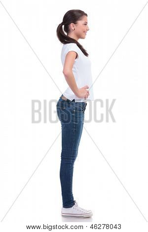 side view of a casual young woman standing with her hands on her hips    Woman Standing Side White Background