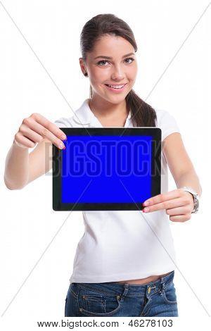 casual young woman presenting a tablet with both hands and a smile. isolated on white background