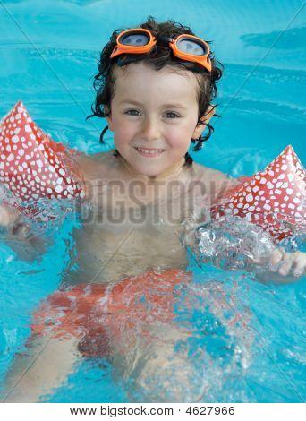 Little Boy Learning To Swim