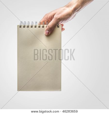 Hand Holding Notebook