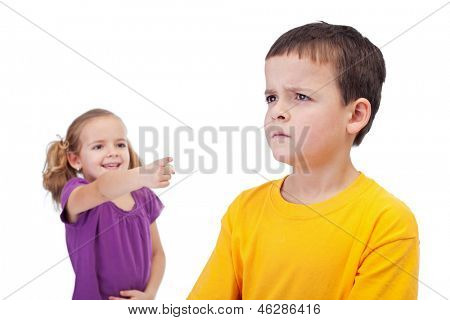 School bullying concept with girl mocking a sad boy - isolated