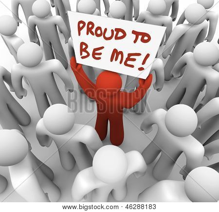 One unique or different person holds a sign in a crowd with the words Proud to Be Me to illustrate standing out in a group of people