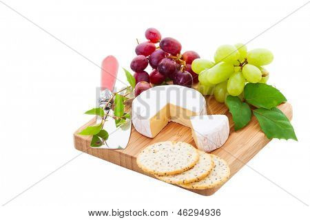 Brie Cheese and crackers with grapes on a white
