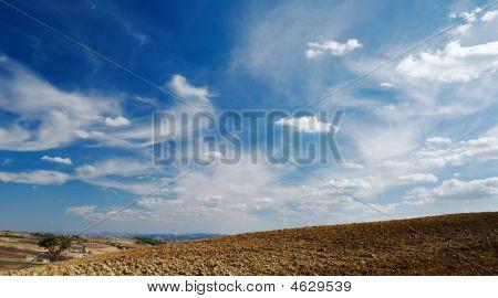 Moody Sky On Plowed Land