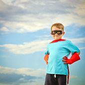 stock photo of guardian  - Child pretending to be a superhero with copy space - JPG