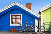 stock photo of red siding  - Colorful houses made of wood and bicycles - JPG