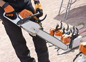 foto of man chainsaw  - the chainsaw in the hands of men - JPG