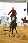 MOSCOW - SEP 6: A man rides horse standing in show of Center for Trick Riding Equestrian Federation