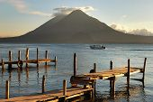 stock photo of pier a lake  - Pier on the Atitlan Lake in Guatemala at Sunset - JPG