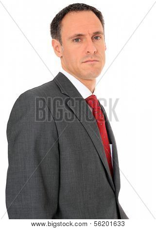 Serious looking businessman. All on white background.