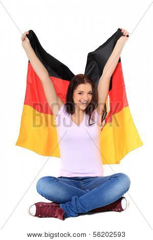 Attractive teenage girl cheering with german flag. All on white background.