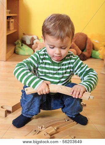 Single kid playing in kindergarten.