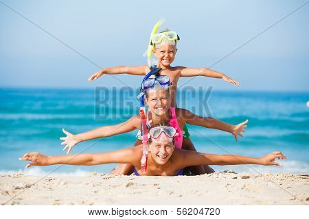 three happy children on beach...