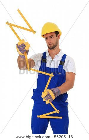 Clumsy construction worker holding folding ruler. All on white background.