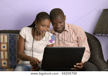 Young African Couple Surfing The Internet