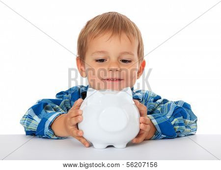 Cute caucasian boy holding piggy bank. All on white background.