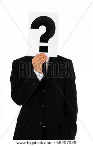 Businessman holding question mark in front of his head. All on white background.