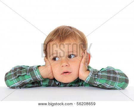 Cute european toddler looking to the side. All on white background.