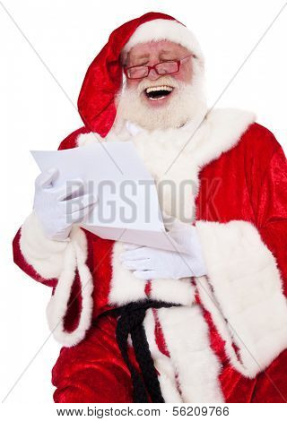 Santa Claus in authentic look having fun reading wish list. All on white background.