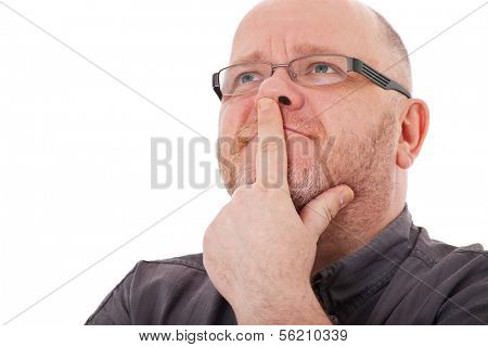 Charismatic adult man deliberates a decision. All on white background.