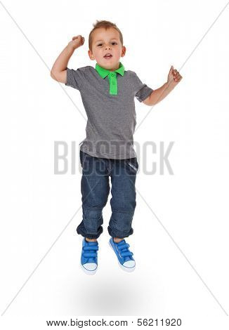 Attractive young boy jumping. All on white background.
