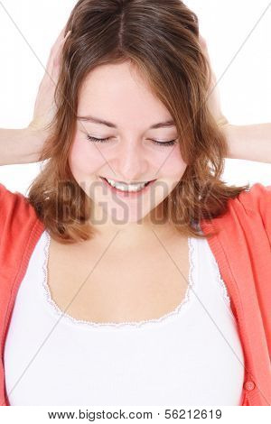 Attractive teenage girl keeps her ears shut. All on white background.