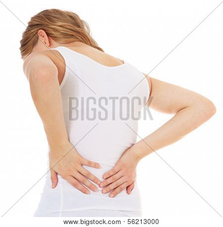 Attractive teenage girl suffers from backache. All on white background.